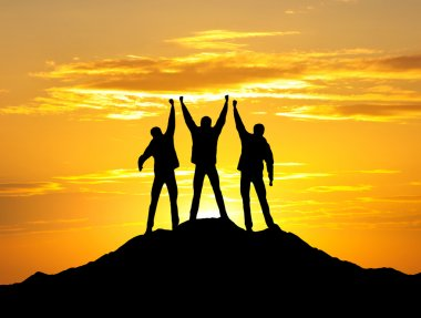 Silhouette of team on the mountain top