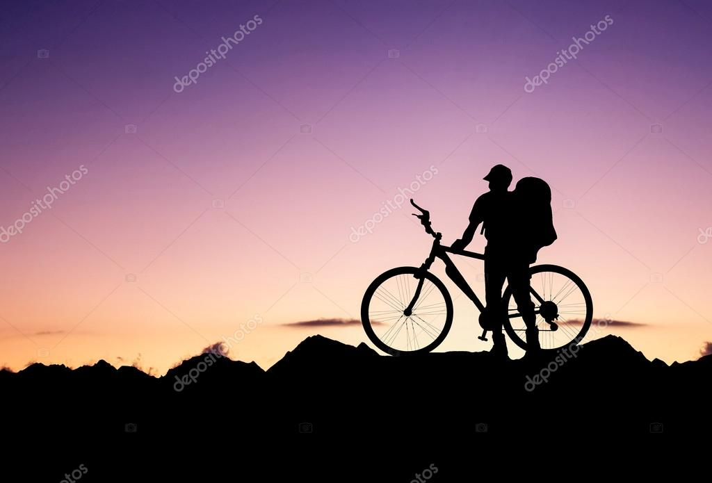 Silhouette of a bike tourist