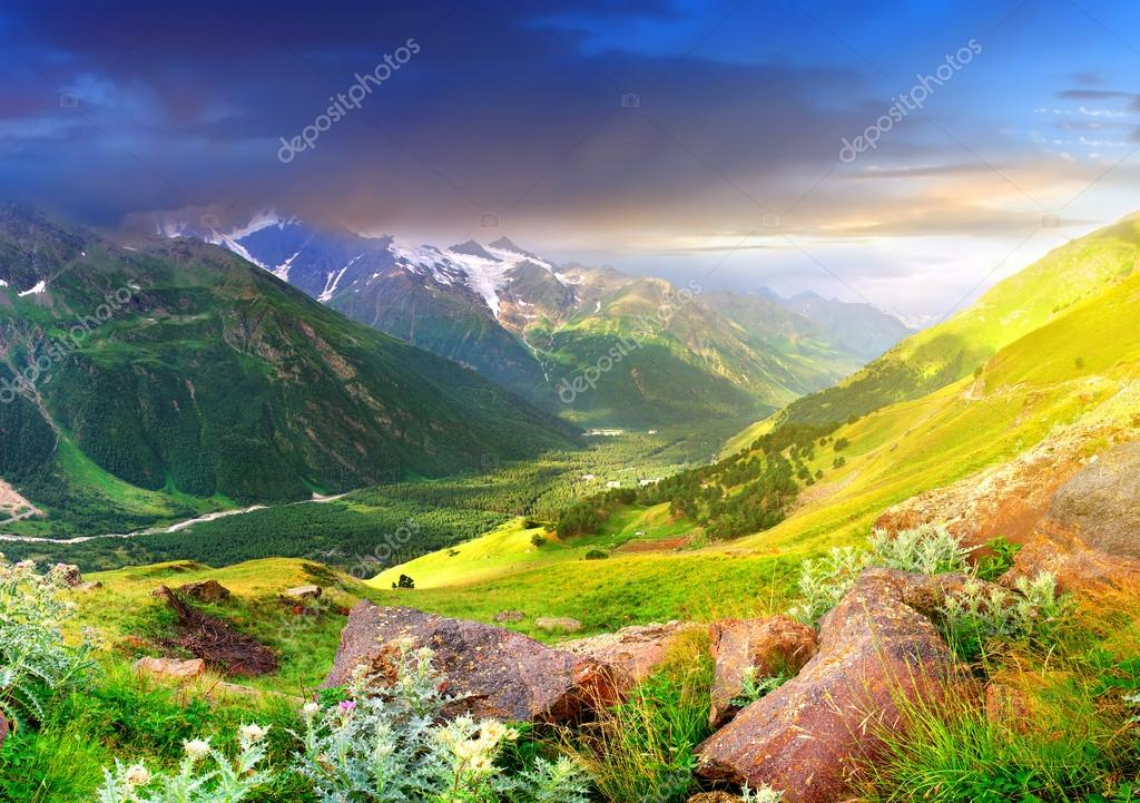 Sundown in large mountain valley