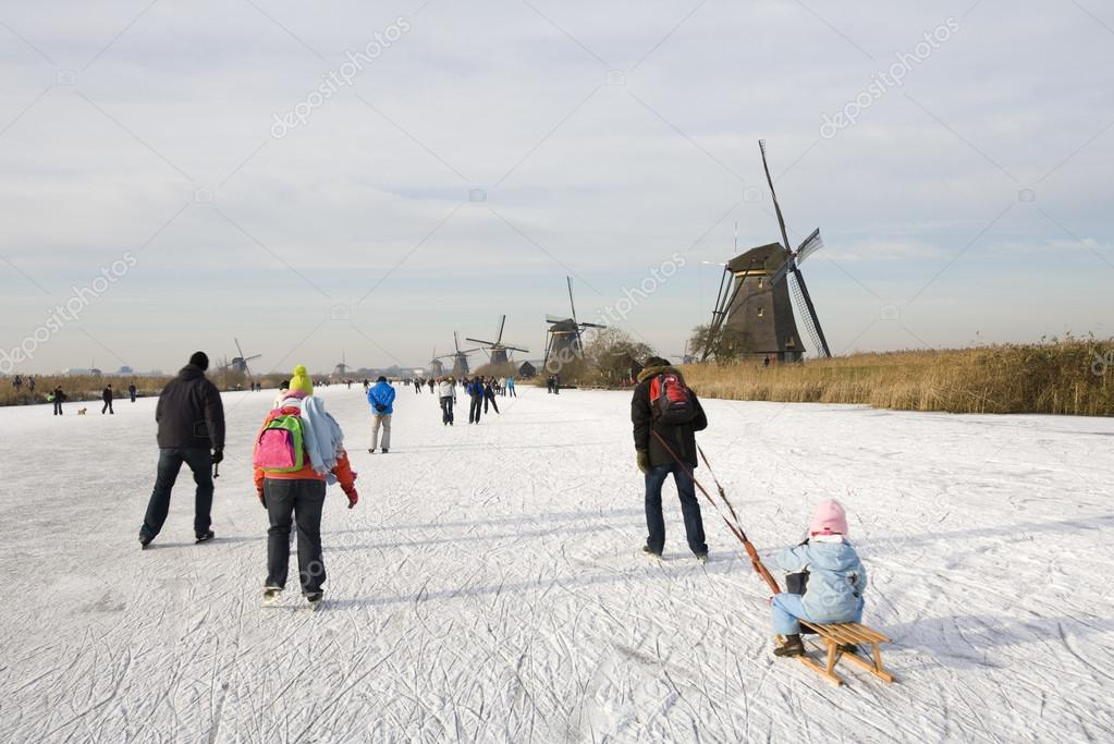 Skating scene with Dutch historic windmills at Kinderdijk