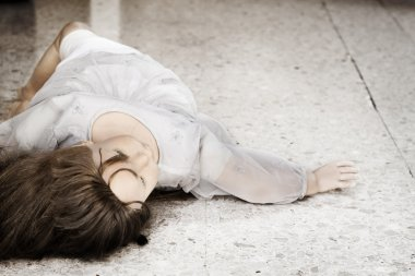 Abandoned doll thrown on the floor