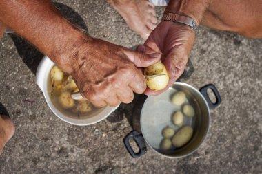 Traditional way of peeling potatoes