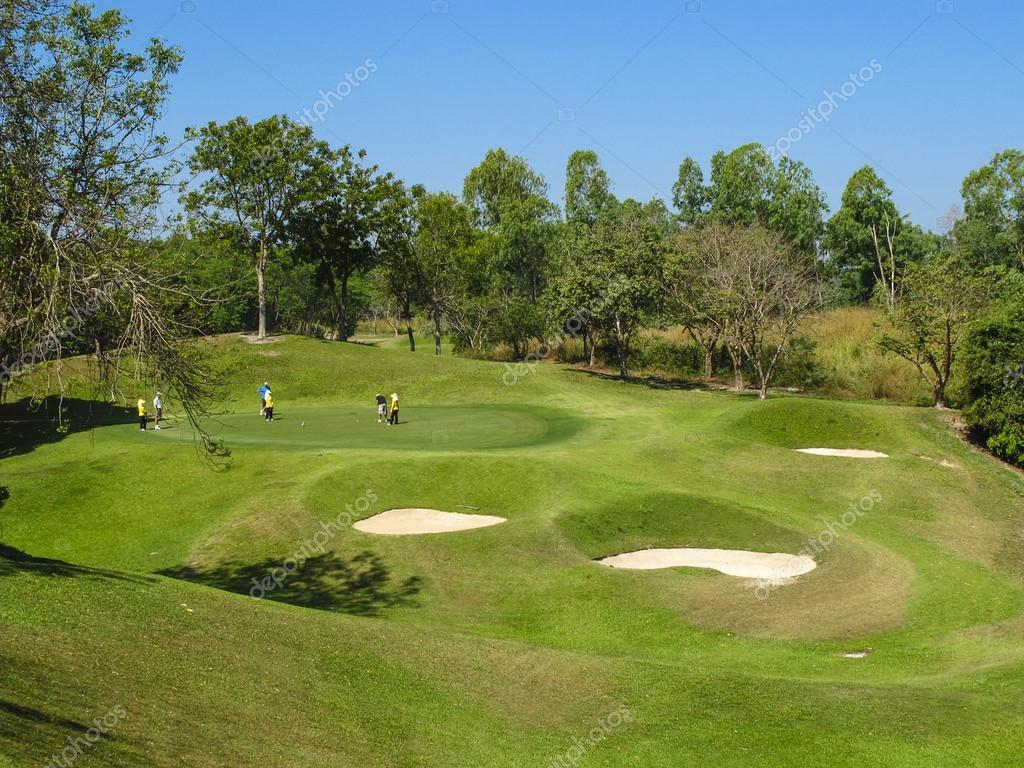 PATTAYA, THAILAND - DECEMBER 28: Unidentified senior men playing golf on a scenic golf course near Pattaya, Chonburi on December 28, 2010.
