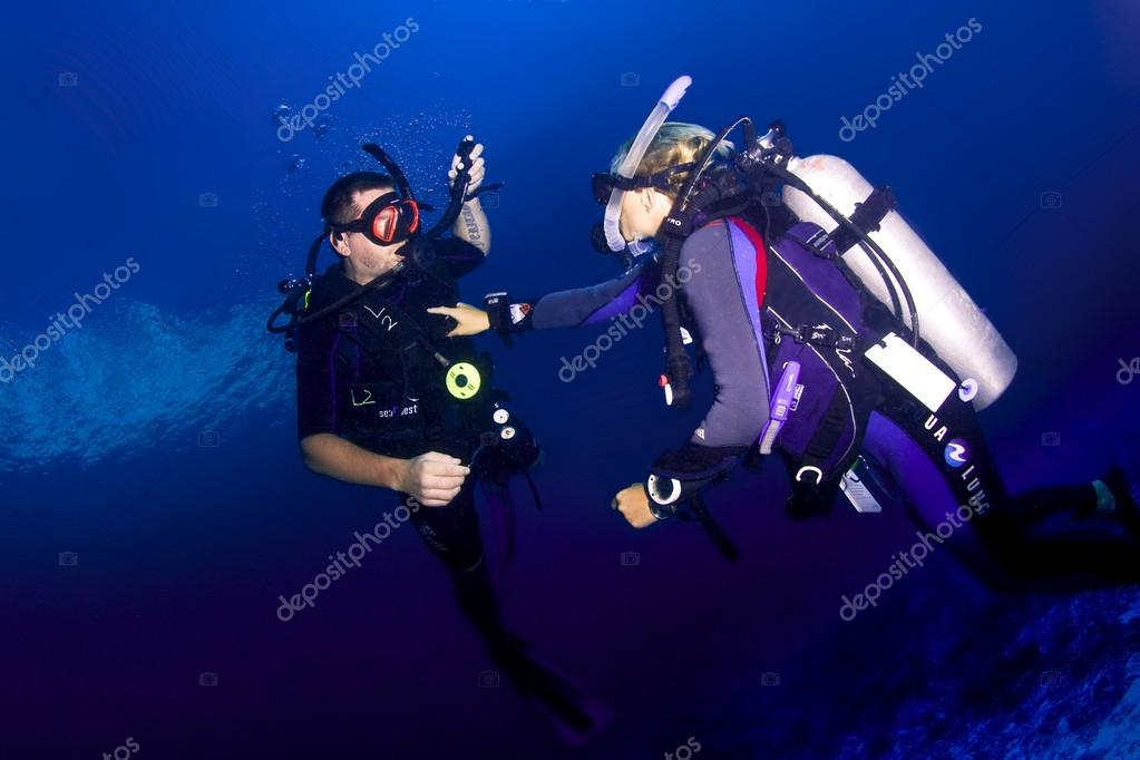 Scuba diving instructor and student