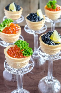 Sandwiches with black and red caviar