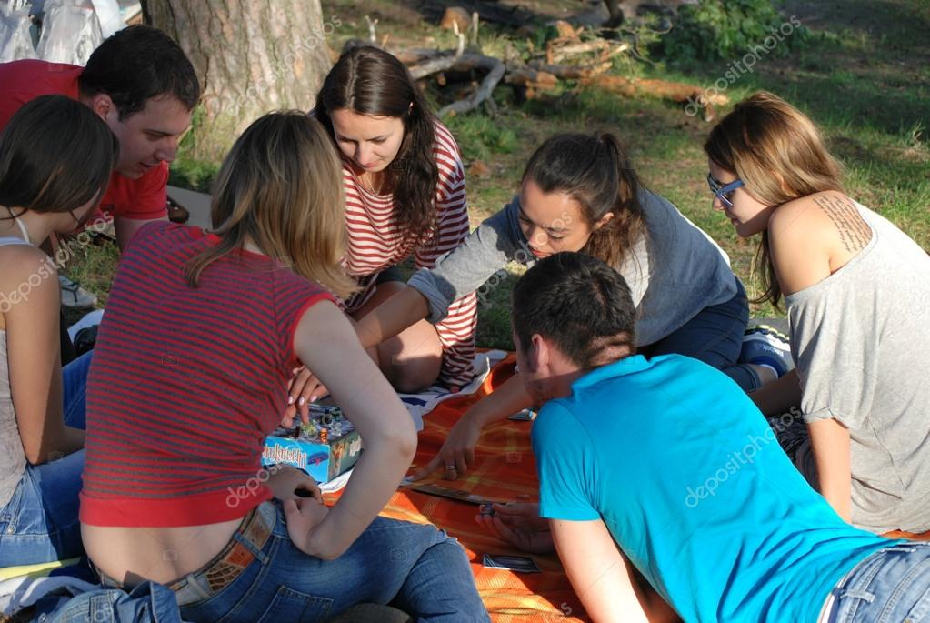 Groups of young people play board games DURING Camping