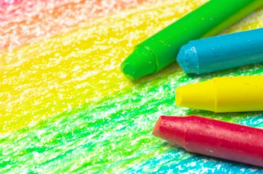 Four crayons and drawing of the rainbow.