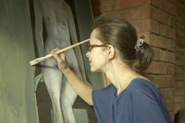 painting a woman