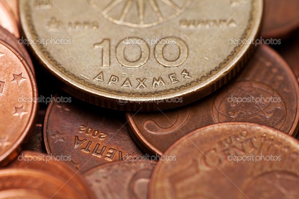 Hundred, drachmas, old Greek coin among euro coins (macro