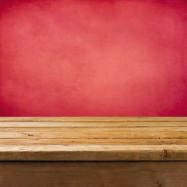 Background with wooden table and pink grunge wall
