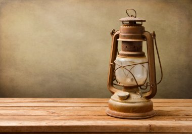 Vintage kerosene lamp on wooden table