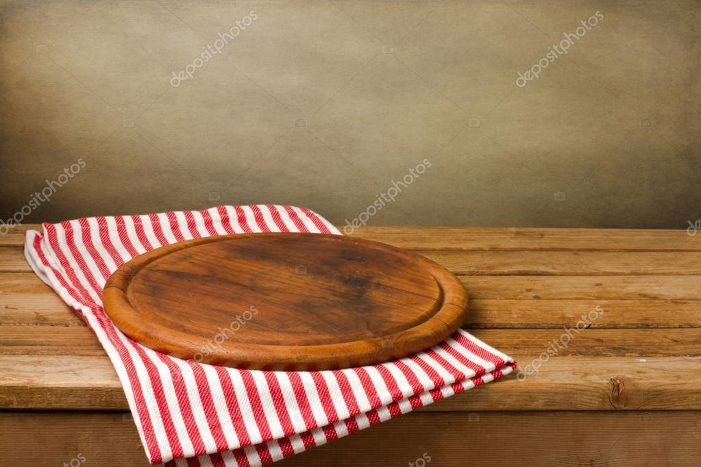 Wooden board stand on tablecloth