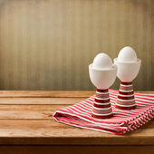 Easter background with eggs on wooden table