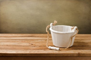 Background with empty wooden bucket
