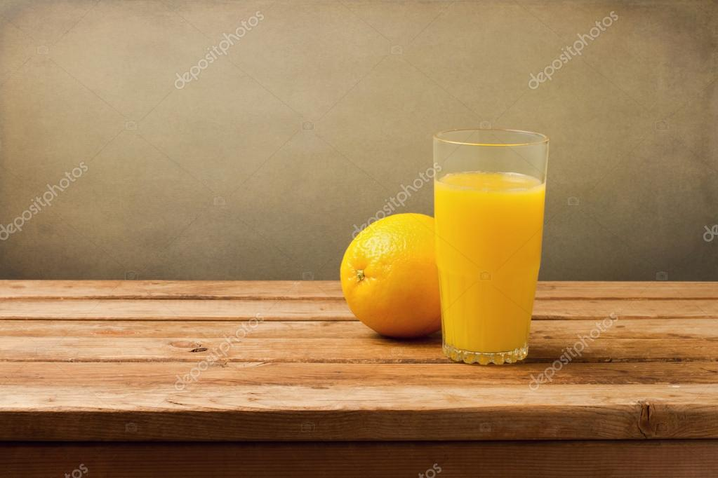 Fresh orange juice on vintage wooden table