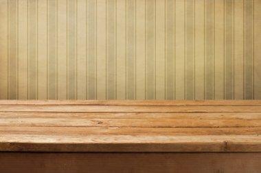 Vintage wooden deck table over retro wallpaper