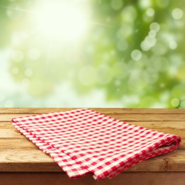 Empty wooden deck table with tablecloth over bokeh background stock vector
