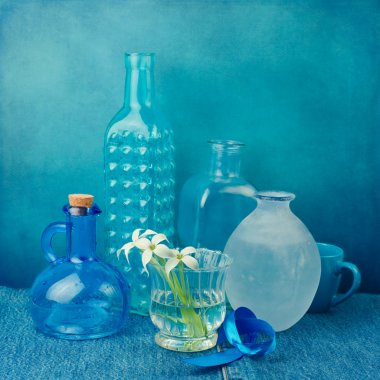 Still life with bottles in blue tones