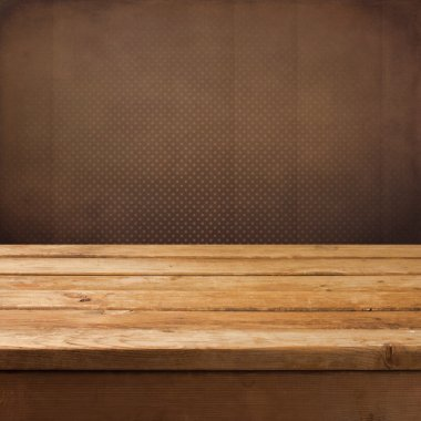 Vintage retro background with wooden table and wallpaper