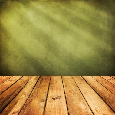Wooden deck floor over green grunge background.