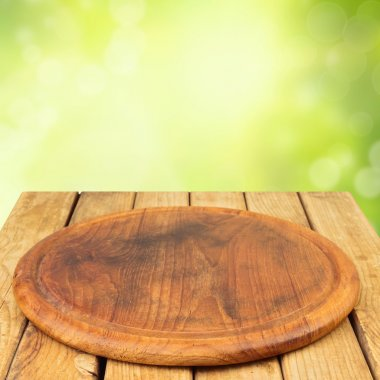 Wooden board on wooden table