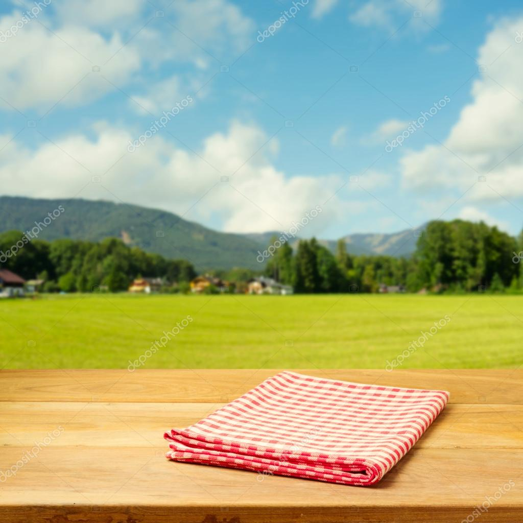 Empty table covered with checked tablecloth