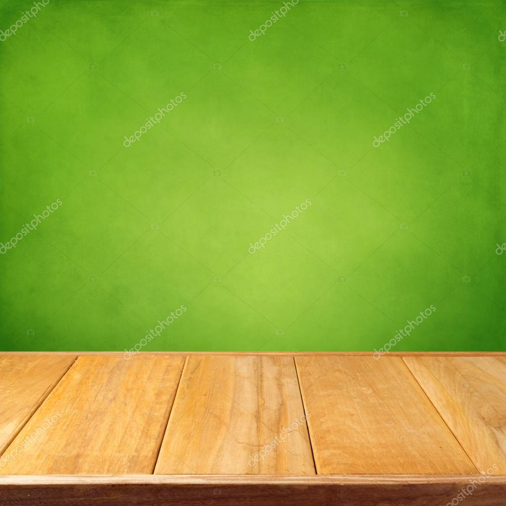 Summer background with wooden empty table and green grunge wallpaper