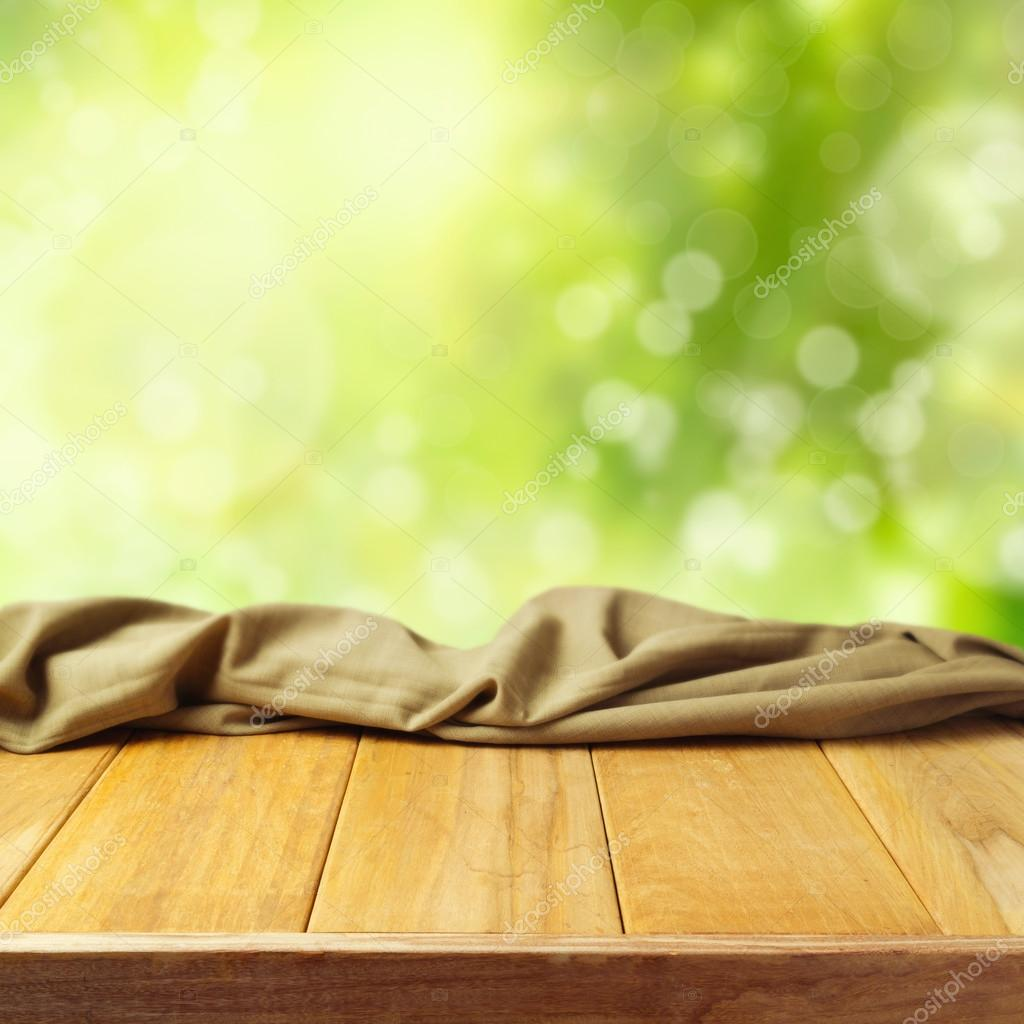 Beautiful background with empty wooden table and bokeh garden