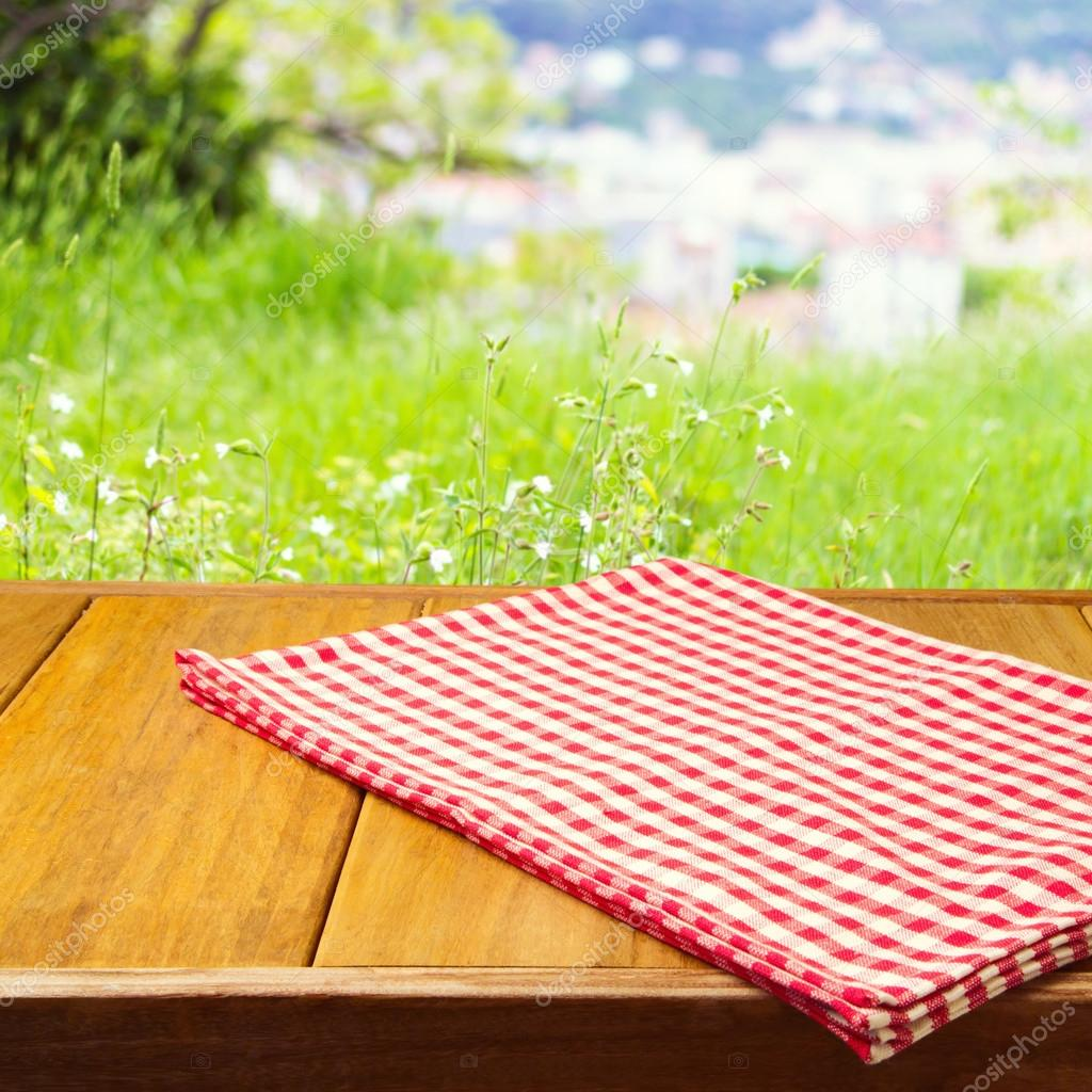 Picnic table background - Background For Product Montage With Tablecloth On Wooden Table Stock Photo