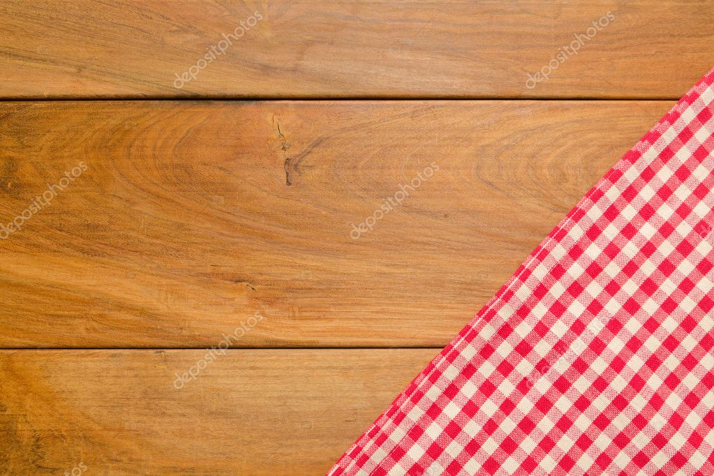Background with wooden tabletop and checked tablecloth Stock