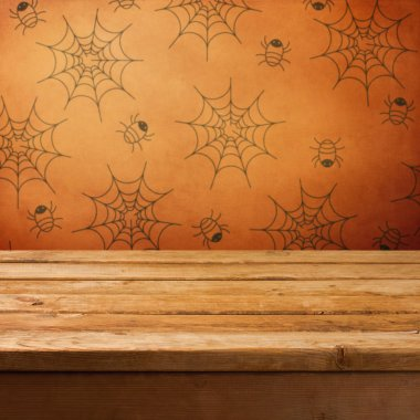 Halloween holiday background with empty wooden table