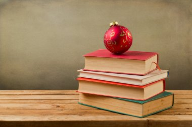 Vintage books with Christmas ornament bauble