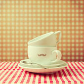 Coffee cups with hipster mustache