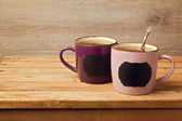 Fotografie Cup of tea with chalkboard stickers