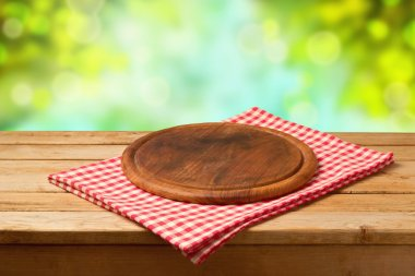 Round board on tablecloth
