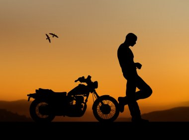 Silhouette of a man with a motorcycle