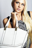 Photo Fashionable beautiful blond woman with with handbag. shopping