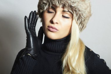 Portrait of Beauty Fashion blond Girl in Fur Hat. Leather Gloves stock vector