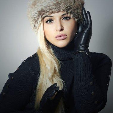 Beautiful Blond Woman in Leather Gloves.Beauty Girl in Fur Cap