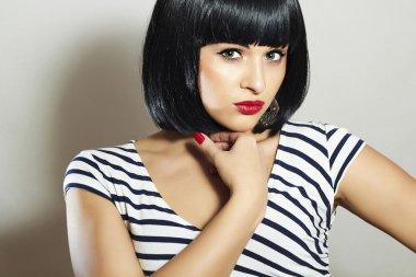 Beautiful Brunette Girl in Dress. Black Hair. bob Haircut. Red Lips. Beauty Woman with Fringe