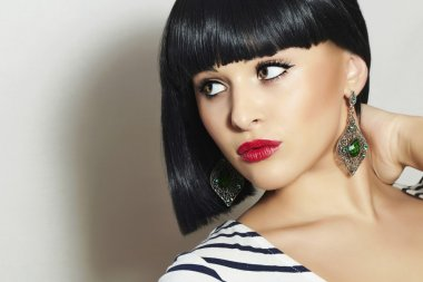 Beautiful Brunette Girl. Healthy Black Hair. Bob Haircut. Red lips. Beauty woman jewelry