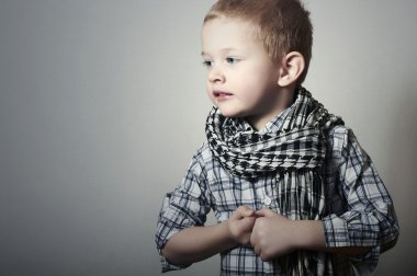 Child. funny little boy in scurf. Fashion Children. 4 years old. Plaid shirt
