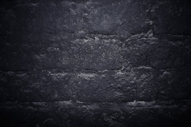 Dark stone wall texture background. Black bricks