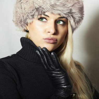 Portrait of Young Woman in Fur Hat. Beautiful Blond Girl in Black Leather Gloves. Winter Fashion Beauty stock vector