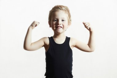 Isolate Child. Funny Little Boy.Sport Handsome Boy. Strong. bodybuilder. showing his hand biceps muscles