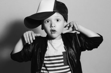 Fashionable little boy.Hip-Hop Style. fashion children.handsome blond kid with big blue eyes.Pose Boy in Tracker Hat. Young Rapper. Funny Child in Cap. 4 years old