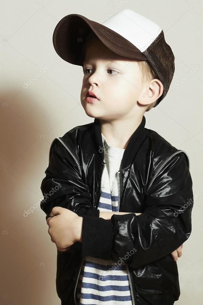 Hip Hop Style Fashion Children Handsome Blond Kid With Big Blue Eyes Pose Boy In Tracker Hat Young Rapper Funny Child In Cap
