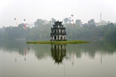 Tortoise Tower is on an island in Hoan Kiem Lake. Hanoi, Vietnam