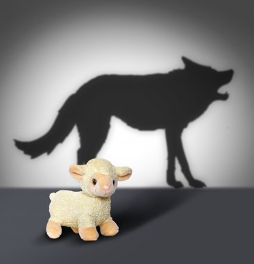 Sheep and wolf shadow. Contept graphic.