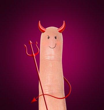Devil on finger - humor contept